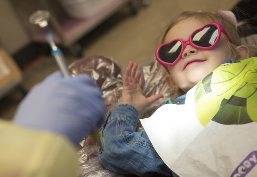 """Reagan Zahn, 2, receives her first dental checkup from her aunt, Katelyn Horan, on Friday, March 3, 2017, at the SIU Community Dental Center. Horan, a junior from New Lenox in the university's dental hygiene program, treated her niece during """"Give Kids a Smile Day,"""" an annual event coordinated by the Southern Illinois Dental Society and the Southern Illinois Dental Hygiene Society. Horan's sister, Melissa Zahn, traveled with Reagan from St. Louis to visit. """"It's nice for her first [dental checkup] that it's family,"""" Zahn said. (Bill Lukitsch 