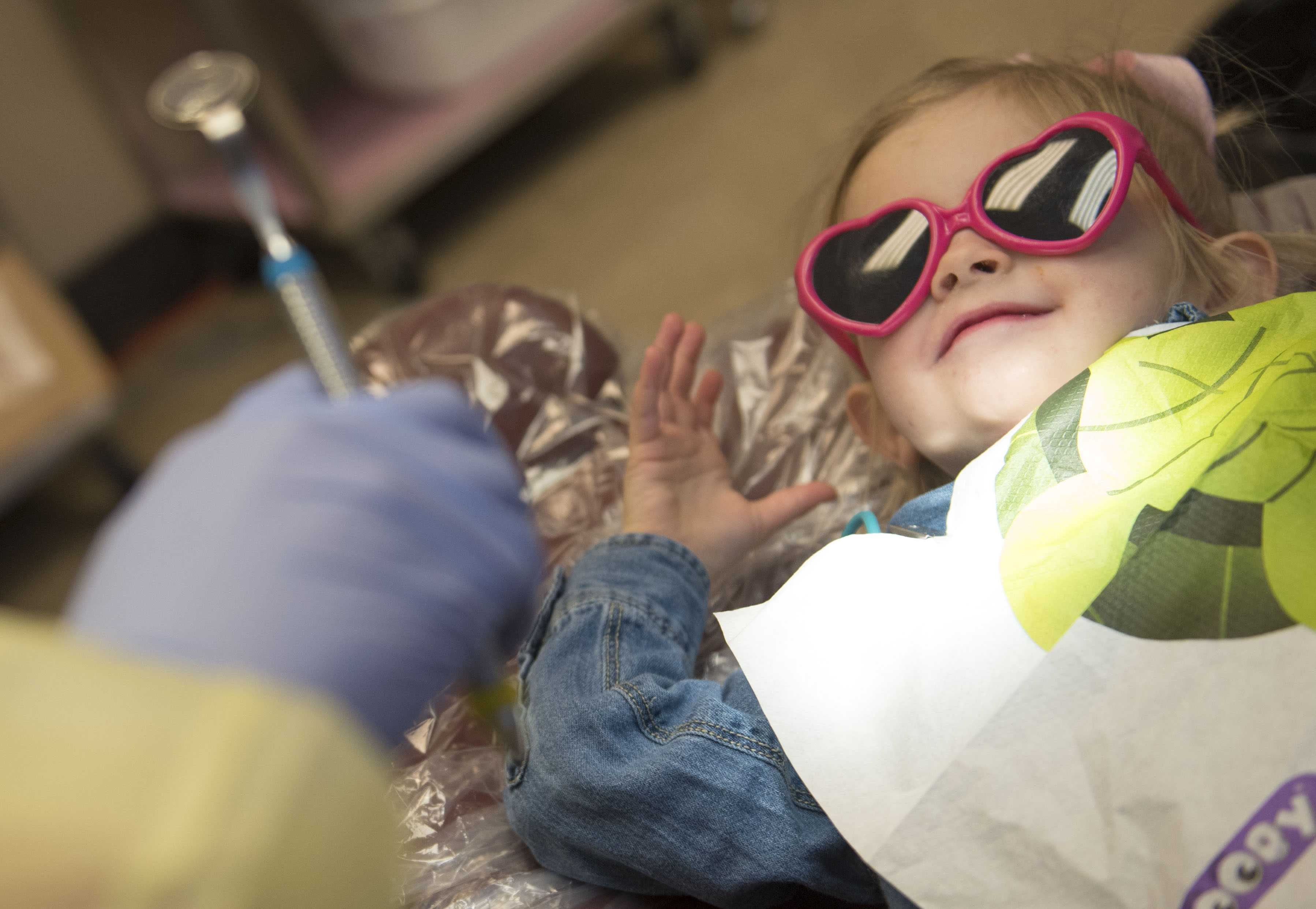 "Reagan Zahn, 2, receives her first dental checkup from her aunt, Katelyn Horan, on Friday, March 3, 2017, at the SIU Community Dental Center. Horan, a junior from New Lenox in the university's dental hygiene program, treated her niece during ""Give Kids a Smile Day,"" an annual event coordinated by the Southern Illinois Dental Society and the Southern Illinois Dental Hygiene Society. Horan's sister, Melissa Zahn, traveled with Reagan from St. Louis to visit. ""It's nice for her first [dental checkup] that it's family,"" Zahn said. (Bill Lukitsch 