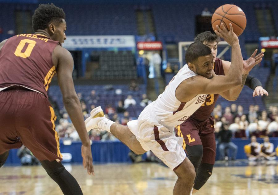 Senior guard Mike Rodriguez loses control of the ball on his way to the basket Friday, March 3, 2017, during the Salukis' 55-50 win against Loyola in the Missouri Valley Conference men's basketball tournament quarterfinals at the Scottrade Center in St. Louis. (Sean Carley | @SeanMCarley)