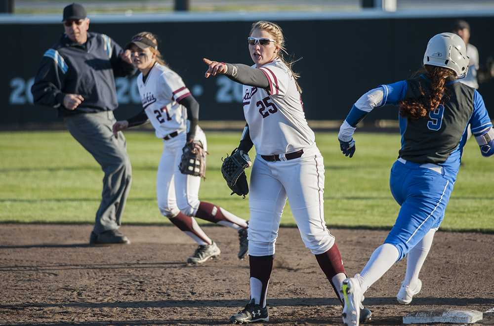 Senior first basewoman Shaye Harre directs another player during a play Friday, March 3, 2017, during SIU's 1-7 loss to the University of Kentucky at Charlotte West Stadium. (Morgan Timms | @Morgan_Timms)