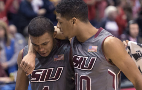 Freshman guard Aaron Cook, right, consoles senior guard Mike Rodriguez as he walks off the floor for the final time in his collegiate career Saturday, March 4, 2017, after SIU's 63-50 loss to Illinois State in the Missouri Valley Conference men's basketball tournament semifinals at Scottrade Center in St. Louis. (Sean Carley | @SeanMCarley)