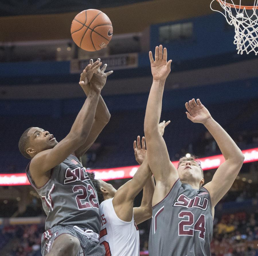 SIU sophomore guard Armon Fletcher (22) and sophomore forward Rudy Stradnieks (24) rise up for a rebound Saturday, March 4, 2017, during SIU's 63-50 loss to Illinois State in the Missouri Valley Conference men's basketball tournament semifinals at Scottrade Center in St. Louis. (Sean Carley | @SeanMCarley)