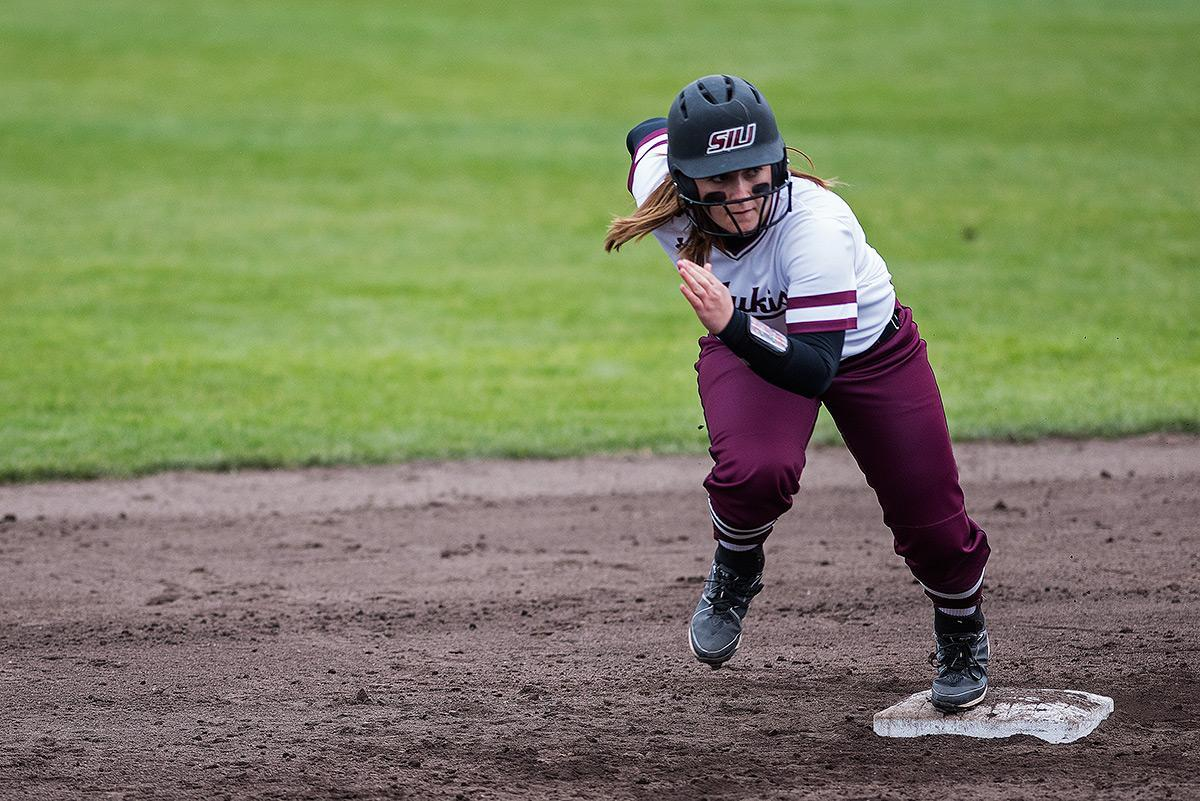 Freshman utility Bailee Pulley runs toward third during SIU's 9-3 loss to the Northern Illinois Huskies on Sunday, March 5, 2017, at Charlotte West Stadium. (Jacob Wiegand | @jawiegandphoto)