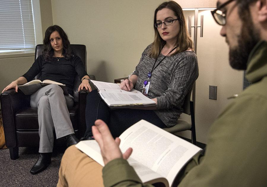 Clinical psychology doctoral candidates Ryan Kimball, of Highland, Utah, right, and Christine Breazeale, of Vicksburg, Mississippi, middle, discuss an assigned reading on progress monitoring with Assistant Professor of Clinical Psychology Sarah Kertz on Monday, March 6, 2017, in SIU's Clinical Center. (Morgan Timms   @Morgan_Timms)