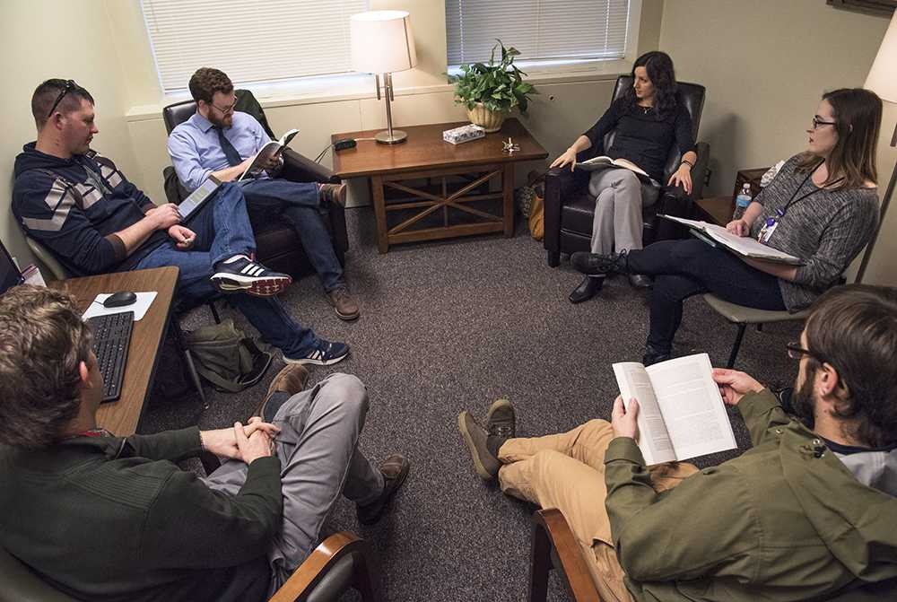 Clinical psychology doctoral candidates discuss progress monitoring from their assigned reading in