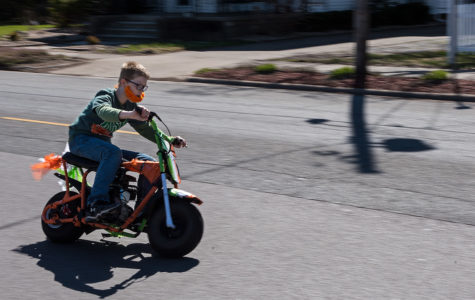 Fourteen-year-old David Penrod, of Murphysboro, rides a mini bike near the end of the St. Patrick's Day Parade on Saturday, March 18, 2017, in Murphysboro. Although Penrod has taken part in the parade in the past, this was his first year doing so while riding a mini bike. (Jacob Wiegand | @jawiegandphoto)