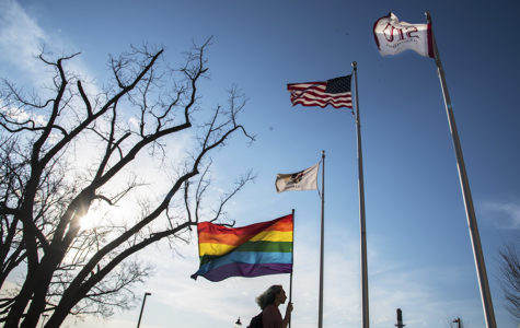 Michael Thornton, a freshman from Naperville studying digital media arts and animation, carries an LGBTQ flag by the Student Services Building en route to astronomy class Monday, March 20, 2017, in Carbondale. Since the inauguration of President Donald Trump, Thornton has been carrying the eight-foot-tall flag everywhere.
