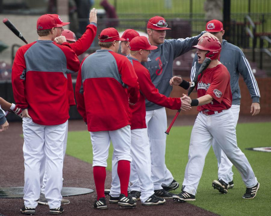 Gamecock junior catcher Hayden White high-fives teammates while he returns to the bullpen Saturday, March 25, 2017, after scoring a run against the Salukis. The Salukis beat the Gamecocks 5-4 during the second of a three-game series at Itchy Jones Stadium. (Bill Lukitsch   @lukitsbill)