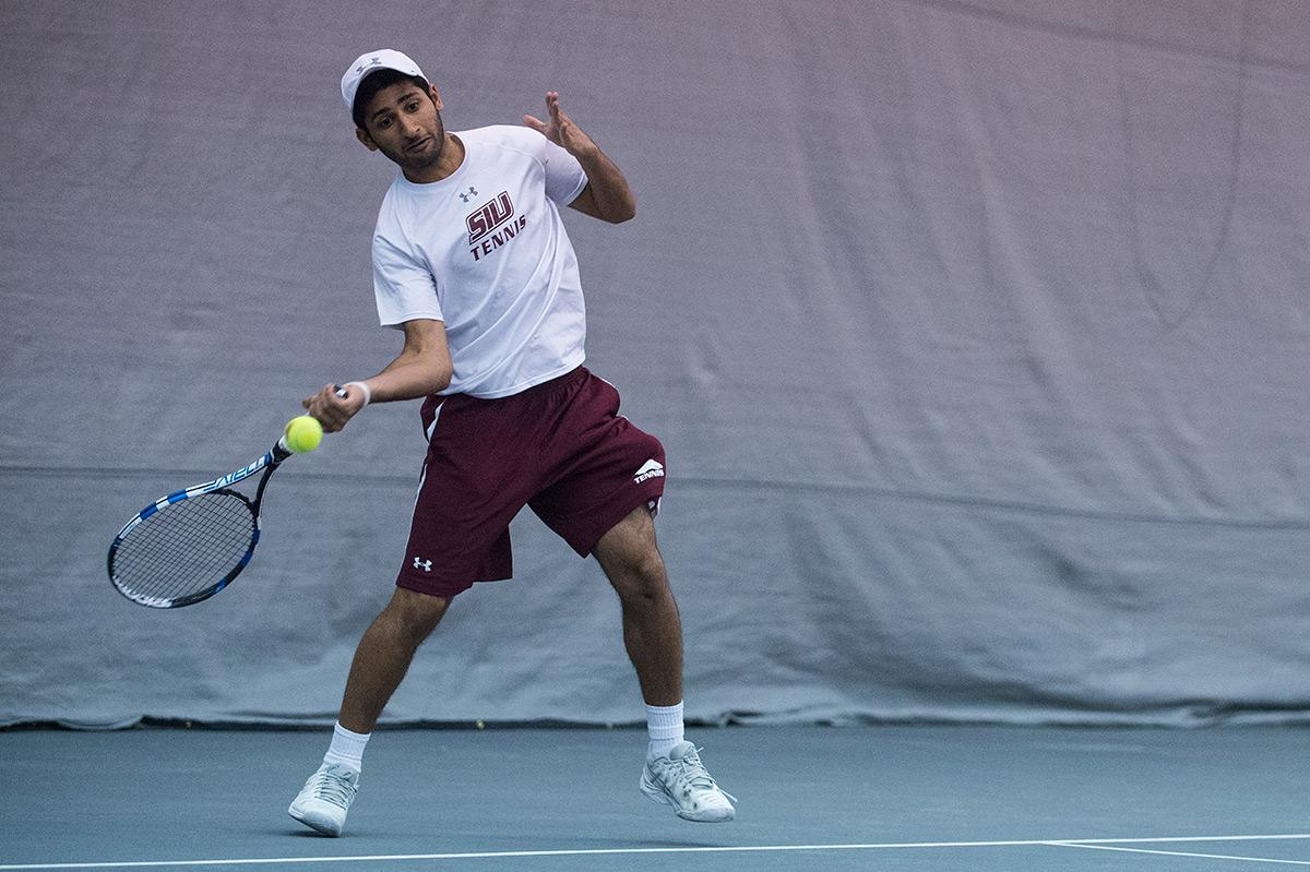 Freshman Param Pun hits a forehand in his singles match during SIU's 7-0 win against Eastern Kentucky on Saturday, March 25, 2017, at Garden Grove Event Center in Carbondale. (Jacob Wiegand | @jawiegandphoto)