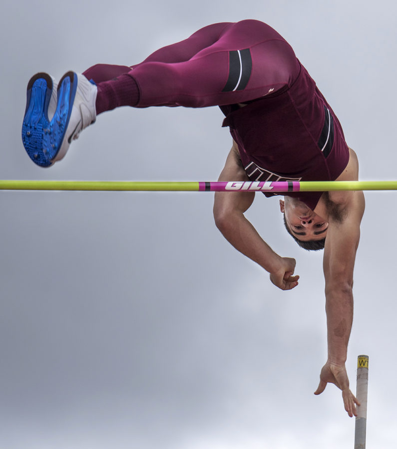 Senior pole vaulter Chad Weaver launches himself over the bar Saturday, March 25, 2017, during the pole vault finals at the Bill Cornell Classic in Carbondale. Weaver placed second in the pole vault to teammate Nathan Schuck. (Morgan Timms | @Morgan_Timms)
