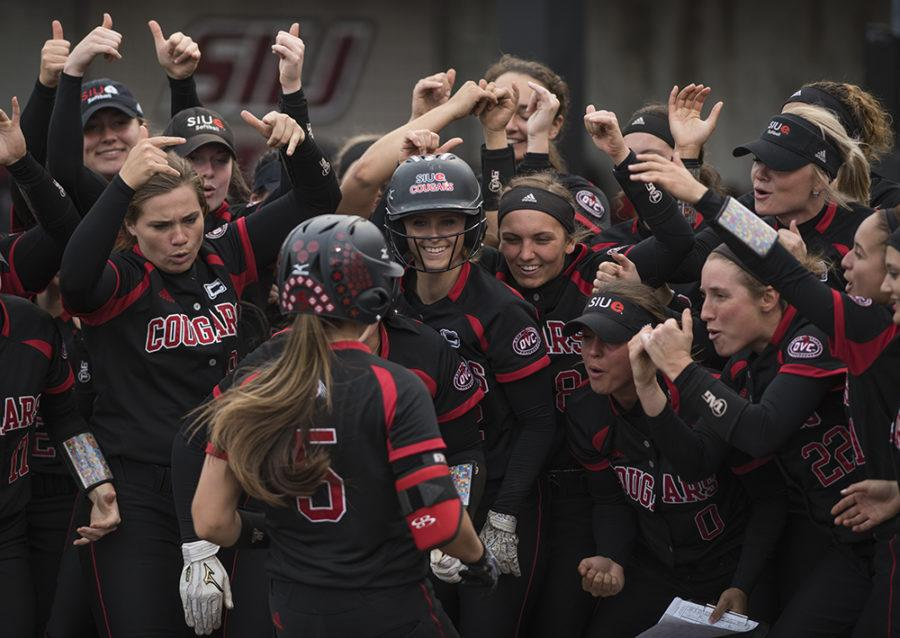 SIUE Cougars welcome home sophomore outfielder Alyssa Heren after her home run Wednesday, March 29, 2017, during the Salukis' 4-0 loss to SIUE at Charlotte West Stadium. (Morgan Timms | @Morgan_Timms)
