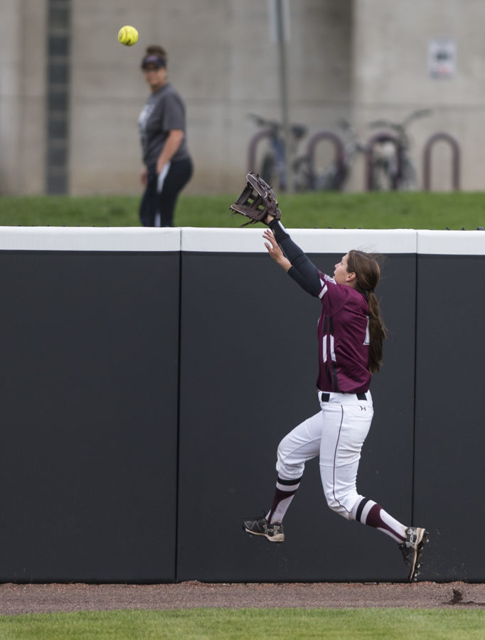 Senior outfielder Merri Anne Patterson reaches for the ball as it goes over the fence Wednesday, March 29, 2017, during the Salukis' 4-0 loss to SIUE at Charlotte West Stadium. (Morgan Timms | @Morgan_Timms)