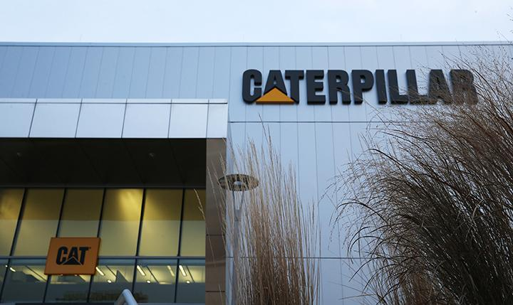 Prairie grass grows in front of the Caterpillar Visitors Center on Jan. 31, 2017, in Peoria, Ill. The company has announced it will move its headquarters to the Chicago area, though many workers will remain in Peoria.