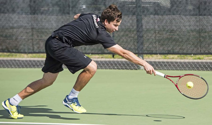 Senior Piotr Baranski reaches for the ball during the last home match in Saluki men's tennis history Saturday, April 1, 2017, at University Courts. The Salukis defeated Wichita State 4-1.  (Athena Chrysanthou | @Chrysant1Athena)