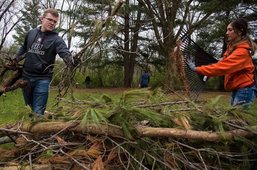 Tyler Chapin, a freshman from Washington, D.C. studying aviation, and Jena Tressler, a senior from Chester studying physical therapist assistant, clear debris Saturday, April 1, 2017, at Touch of Nature Environmental Center in Makanda. Chapin and Tressler volunteered at Touch as part of The Big Event — a day of service in which hundreds of SIU students participated. (Jacob Wiegand | @jawiegandphoto)