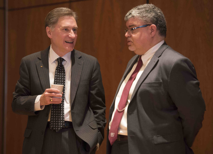 SIU+President+Randy+Dunn+speaks+to+interim+Chancellor+Brad+Colwell+on+Thursday%2C+April+6%2C+2017%2C+during+a+recess+of+the+SIU+Board+of+Trustees+meeting+in+the+Student+Center+ballrooms.+%28Bill+Lukitsch+%7C+%40lukitsbill%29