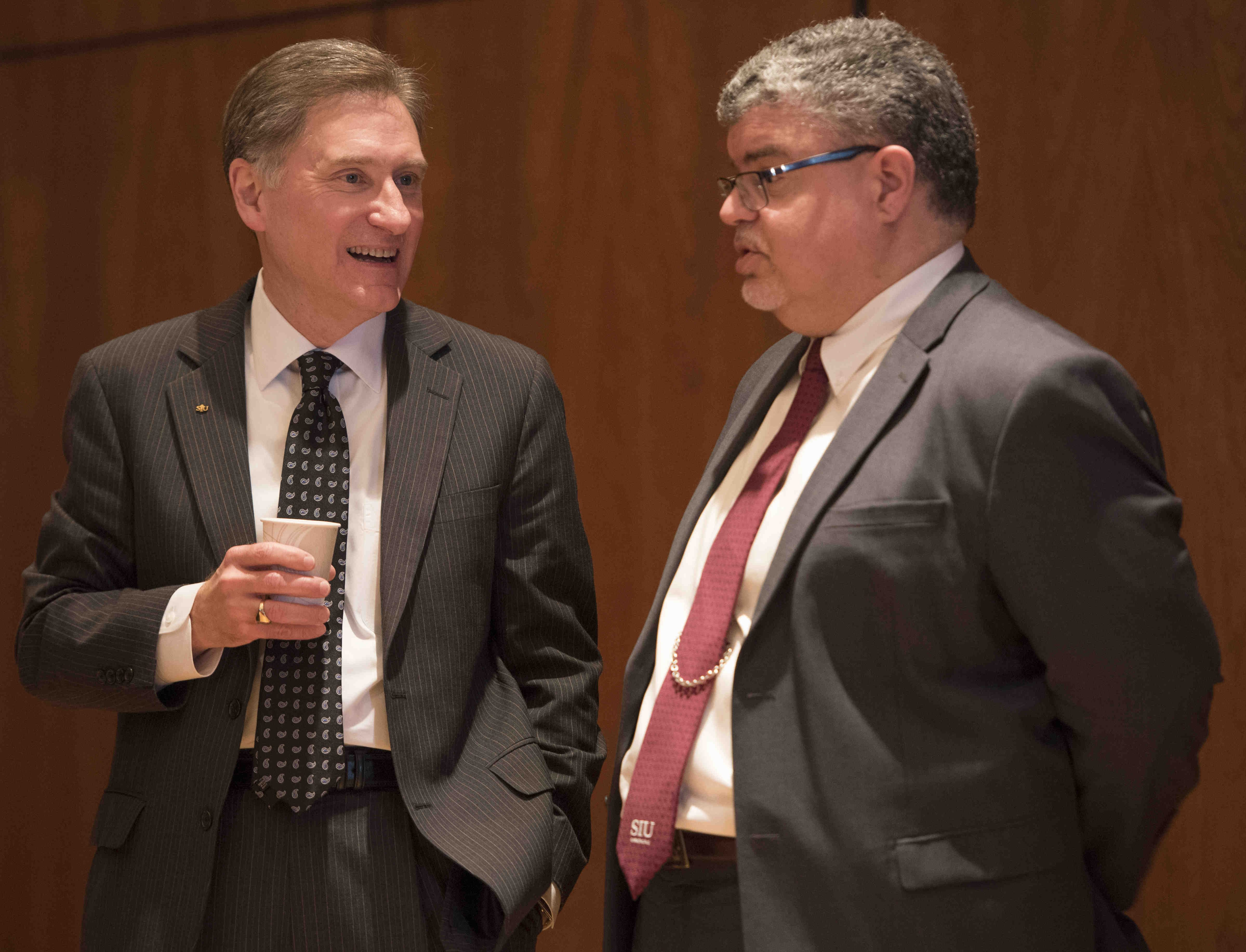 SIU President Randy Dunn speaks to interim Chancellor Brad Colwell on Thursday, April 6, 2017, during a recess of the SIU Board of Trustees meeting in the Student Center ballrooms. (Bill Lukitsch | @lukitsbill)