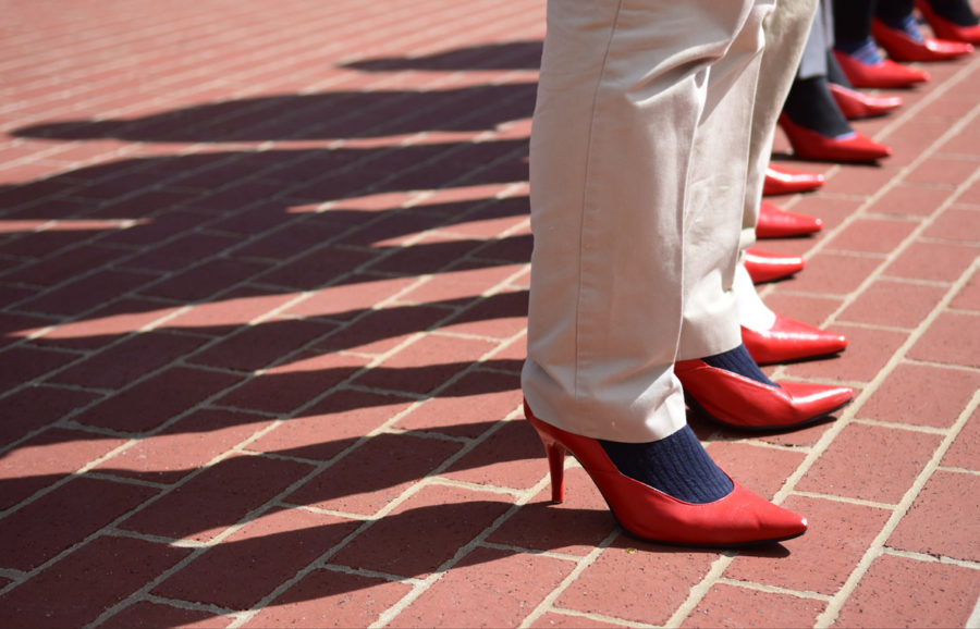 Members+of+the+Kappa+Alpha+Order+stand+in+red+high+heels+Thursday%2C+April+6%2C+2017%2C+during+the+Walk+a+Mile+in+Her+Shoes+event+held+on+campus+to+spread+sexual+assault+awareness.+%28Athena+Chrysanthou+%7C+%40Chrysant1Athena%29