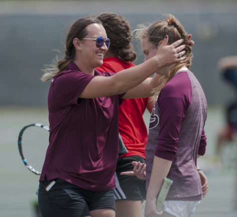 Graduate assistant coach Raluca Mita congratulates senior Meagan Monaghan on Sunday, April 9, 2017, after Monaghan won a match against Bradley sophomore Malini Wijesinghe at the University Courts. The Salukis beat the Braves 4-3. (Bill Lukitsch | @lukitsbill)