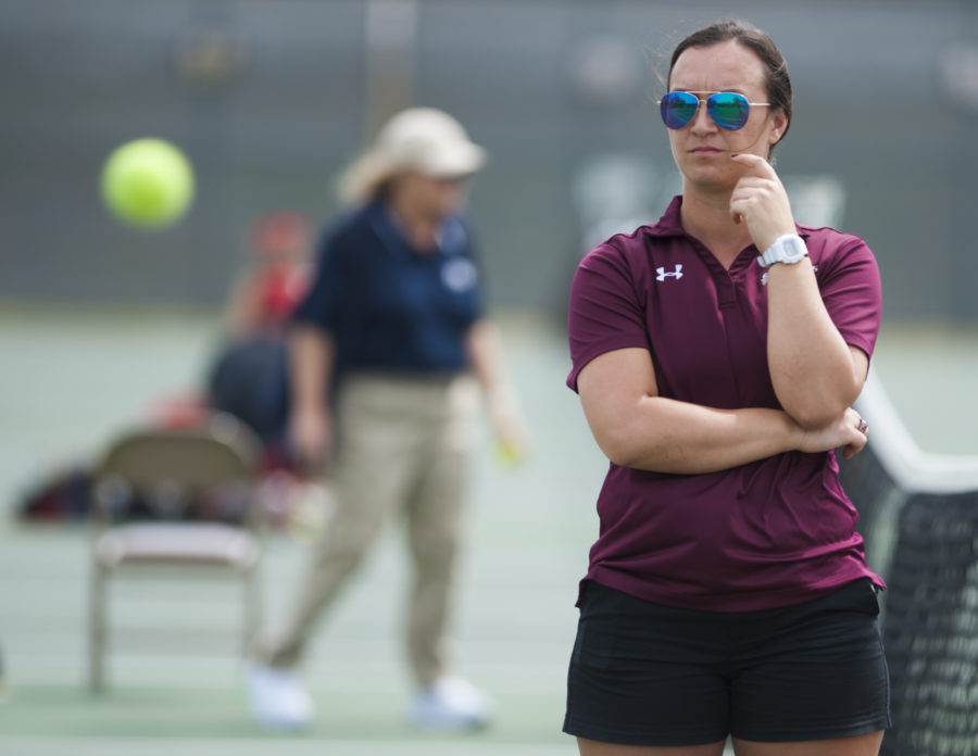 Graduate+assistant+coach+Raluca+Mita+observes+a+match+Sunday%2C+April+9%2C+2017%2C+during+the+Salukis%E2%80%99+4-3+win+against+the+Bradley+Braves+at+the+University+Courts.+%28Bill+Lukitsch+%7C+%40lukitsbill%29+