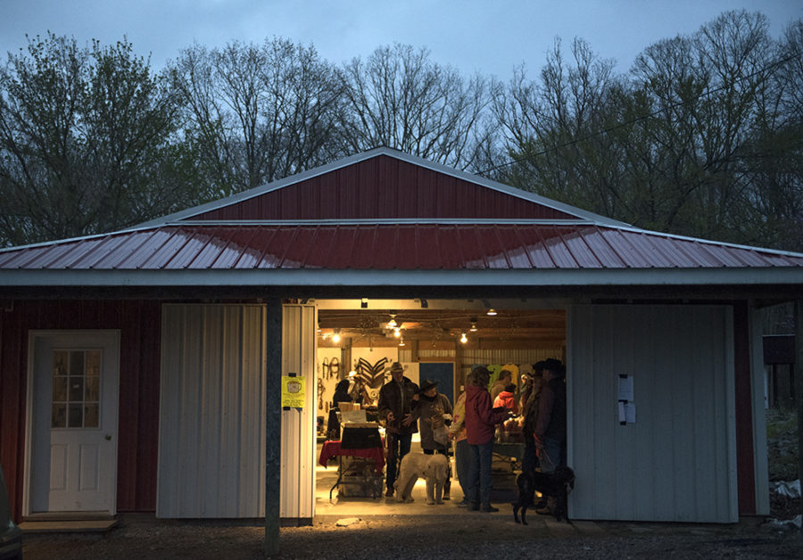 Mule riders gather with their dogs to browse vendors and mingle after a long day of trail riding Wednesday, April 5, 2017, during the second annual McAllister and Friends Mule Ride at High Knob Campground in the Shawnee National Forest. (Morgan Timms | @Morgan_Timms)