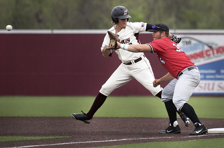 Southeast Missouri junior infielder Tristen Gagan attempts to catch out senior outfielder Dyllin Mucha at first base Tuesday, April 11, 2017, during the Salukis' 4-2 win against the Redhawks at Itchy Jones Stadium. (Morgan Timms | @Morgan_Timms)
