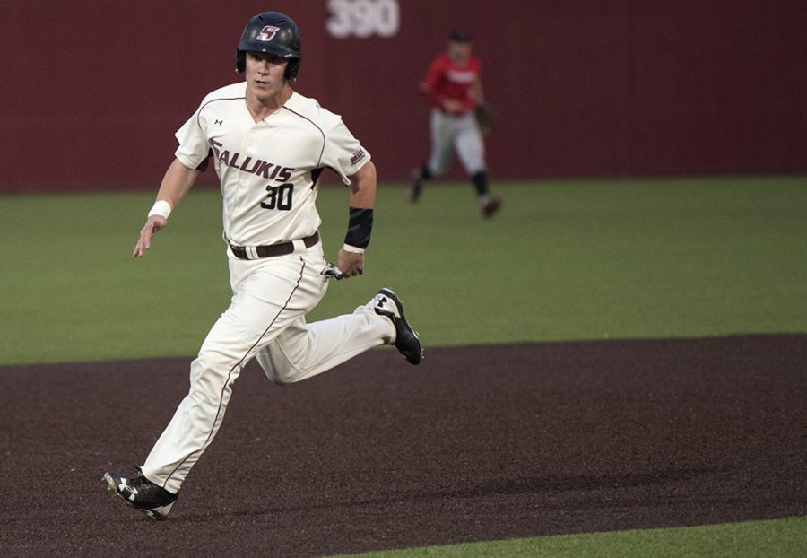 Junior center Nick Hutchins sprints to third base Tuesday, April 11, 2017, during the Salukis' 4-2 win against Southeast Missouri at Itchy Jones Stadium. (Morgan Timms | @Morgan_Timms)
