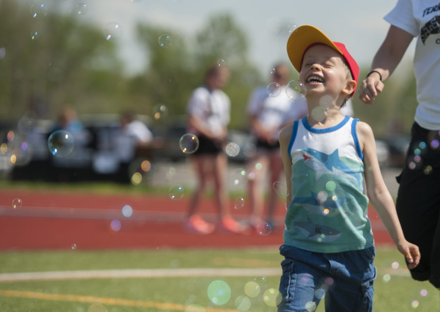 Joshua Thomas, 5, plays with bubbles Saturday, April 15, 2017, before the start of a Color Fun Run/Walk 5K around campus. Joshua's mother, Michelle Thomas, a teacher at Carbondale Community High School, said he was diagnosed with autism at 18 months old. The run was organized by the southern Illinois chapter of the Autism Society of America as a way to raise donations for autism research and awareness. (Bill Lukitsch | @lukitsbill)