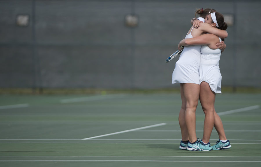 Saluki senior Polina Dozortseva, left, and junior Vitoria Beirao embrace Saturday, April 15, 2017, following Dozortseva's singles match. The Salukis beat the Missouri State Bears 6-1 during the final home tennis match in program history at the University Courts. (Bill Lukitsch | @lukitsbill)