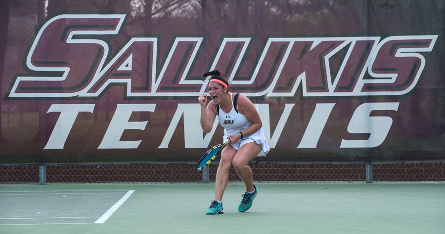 """Junior Athena Chrysanthou reacts to winning a point during her singles match against Missouri State junior Anelisse Torrico Moreno during the Salukis' 6-1 win against the Bears on Saturday, April 15, 2017, at the University Courts. Chrysanthou won her match 4-6, 6-2 and 10-5 in a deciding tiebreaker. """"It's always good to see a teammate win especially when it's tight and their the last one,"""" said senior Ana Sofia Cordero when asked about Chrysanthou's win. """"It's just another special moment to add to this day."""