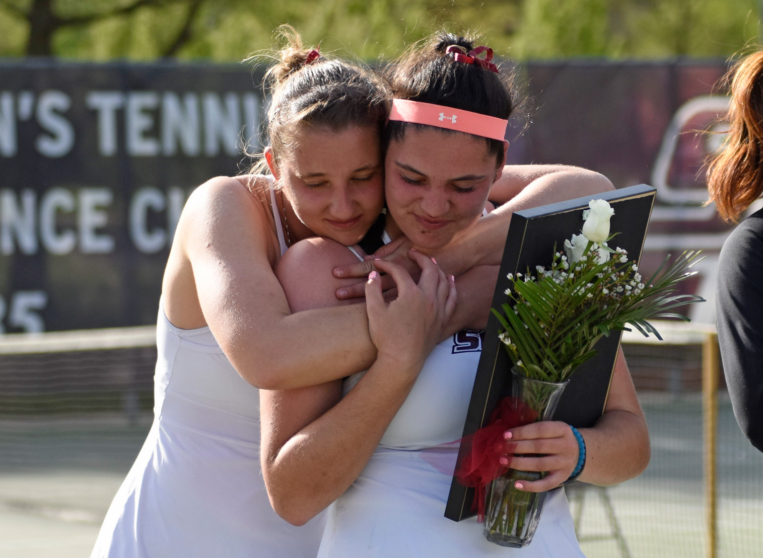 Senior+Polina+Dozortseva+and+junior+Athena+Chrysanthou+embrace+on+Saturday%2C+April+15%2C+2017%2C+during+a+senior+day+awards+ceremony+following+the+final+home+match+in+program+history.+In+January%2C+SIU+athletics+announced+that+it+would+cut+the+men%E2%80%99s+and+women%E2%80%99s+tennis+teams+effective+July+1.+%28Anna+Spoerre+%7C+%40annaspoerre%29