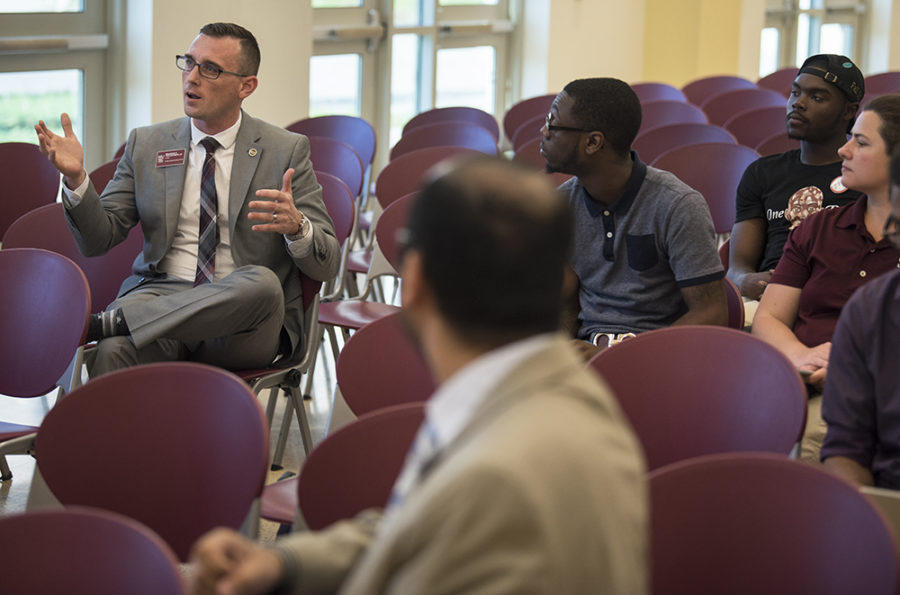 Brandon Woudenberg, president of the Graduate and Professional Student Council, asks chancellor candidate George Hynd how he plans to support the international student body on Wednesday, April 19, 2017, during an open forum in the Student Services Building. (Morgan Timms | @Morgan_Timms)