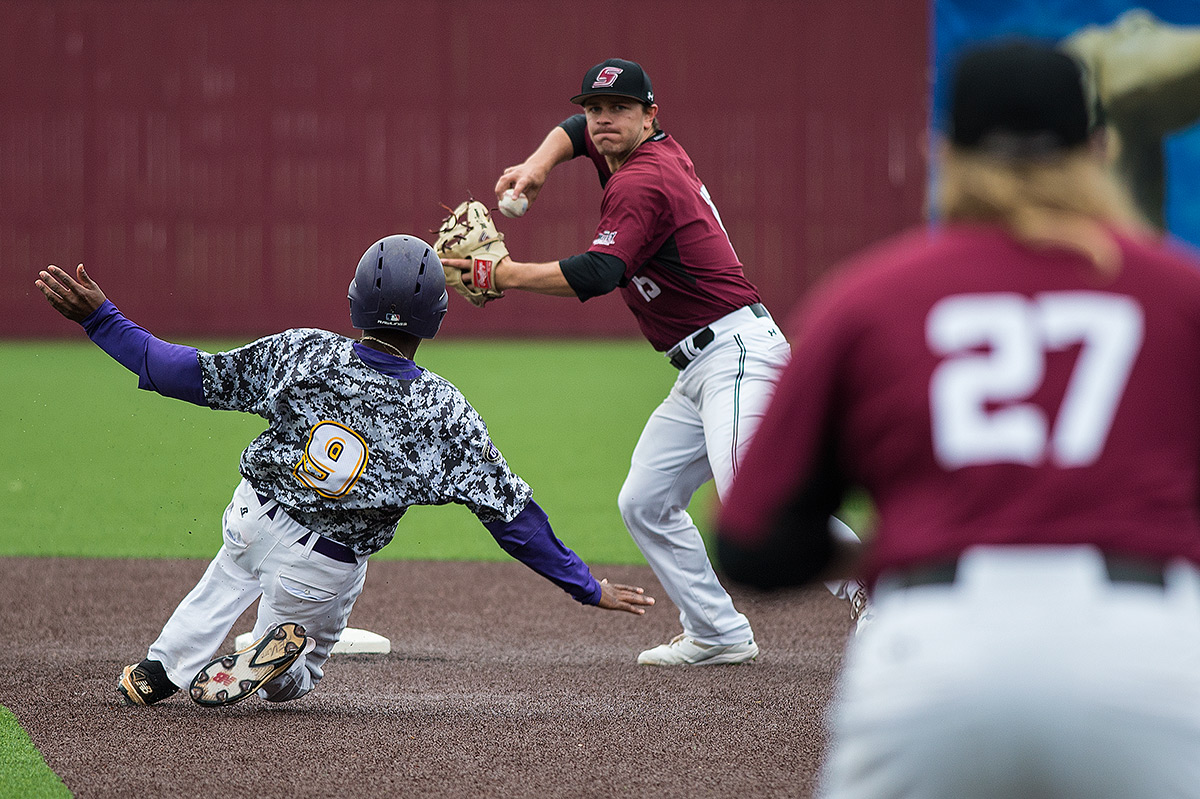 Saluki senior infielder Will Farmer prepares to throw toward junior infielder Greg Lambert as Golden Eagle sophomore outfielder Alex Junior prepares to slide into second during SIU's 6-4 win in the first game of a doubleheader against Tennessee Tech on Saturday, April 22, 2017, at Itchy Jones Stadium. (Jacob Wiegand | @jawiegandphoto)