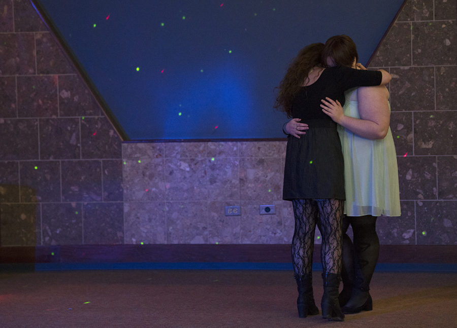 Dawn Lester, a senior from Oblong studying journalism, and Caitlin Blaylock, of St. Louis, embrace Saturday, April 22, 2017, during the SIU LGBTQ Resource Center's third annual Pride Prom at Grinnell Hall in Carbondale. The two have been dating for six months. (Morgan Timms | @Morgan_Timms)