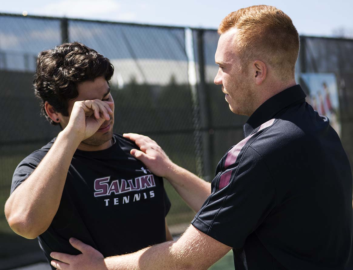 SIU+men%27s+tennis+graduate+assistant+Jonny+Rigby+comforts+junior+Alex+Pozo+Saturday%2C+April+1%2C+2017%2C+after+the+Salukis%27+beat+Wichita+State+4-1+in+the+last+home+match+in+Saluki+men%27s+tennis+history+at+University+Courts.+%28Athena+Chrysanthou+%7C+%40Chrysant1Athena%29