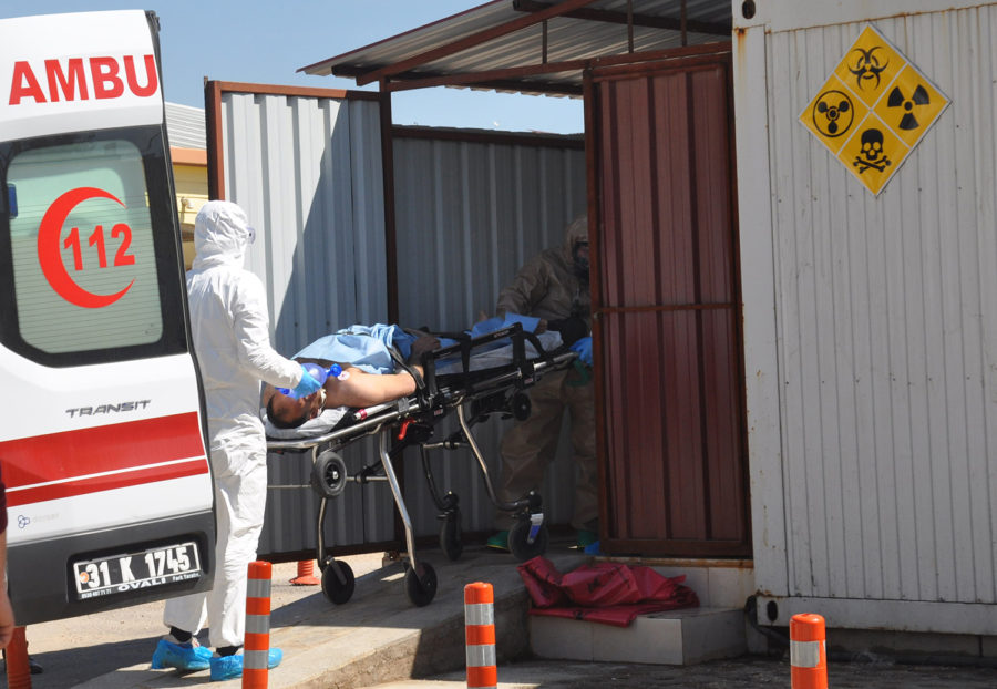 Turkish experts evacuate a victim of a suspected chemical weapons attacks in the Syrian city of Idlib, at a local hospital in Reyhanli on April 4, 2017. At least 58 people have been killed and dozens wounded in a suspected chemical attack on a rebel-held town in north-western Syria, a monitoring group says. Around 30 Turkish ambulances gathered at the border in Hatay province for medical evacuation of victims after Syria toxic gas attack, to be brought to Turkey. (Ferhat Dervisoglu/Depo Photos/Zuma Press/TNS)