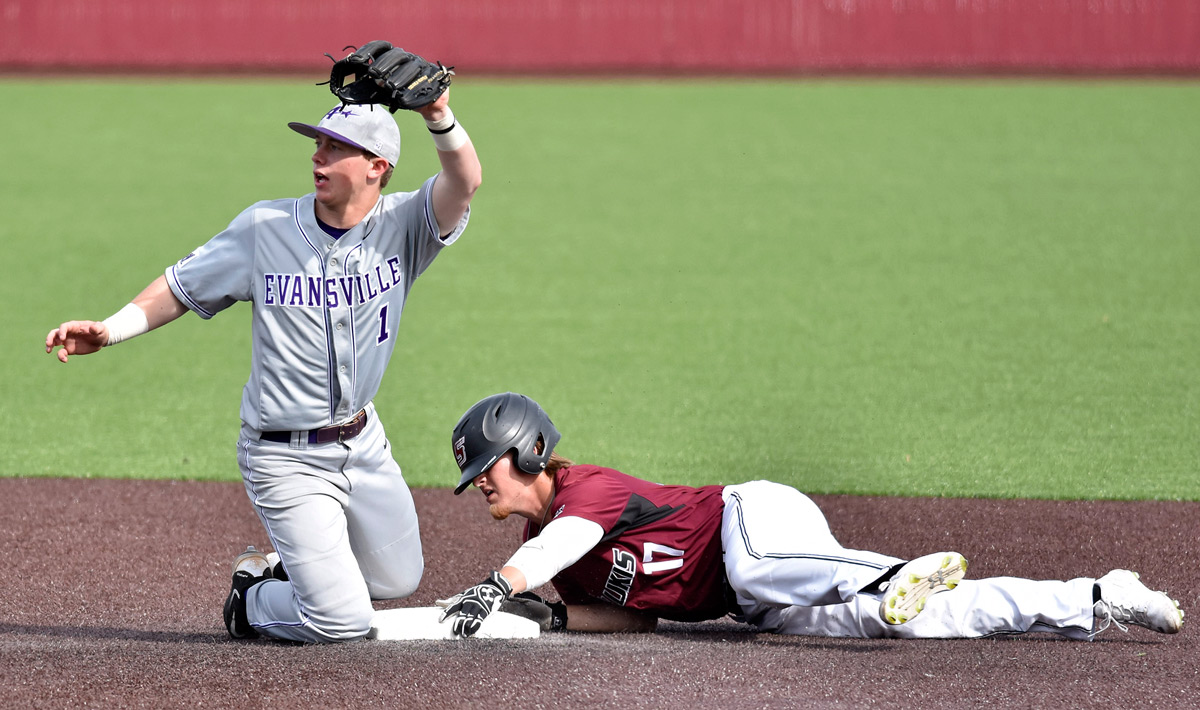 Evansville freshman infielder Craig Shepherd catches the ball Sunday, April 2, 2017, to get Saluki senior outfielder Dyllin Mucha out during SIU's 8-3 win against the Purple Aces at Itchy Jones Stadium. (Luke Nozicka | @lukenozicka)