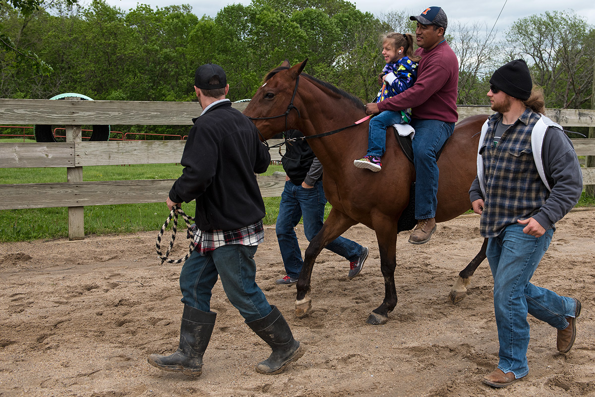 Equine physical therapy - Kennedy Baker 7 Of Goreville Rides Dauber With Santiago Tomas On Back Of Horse While Nathan Alcorn A Senior From Galesburg Studying Outdoor Recreation