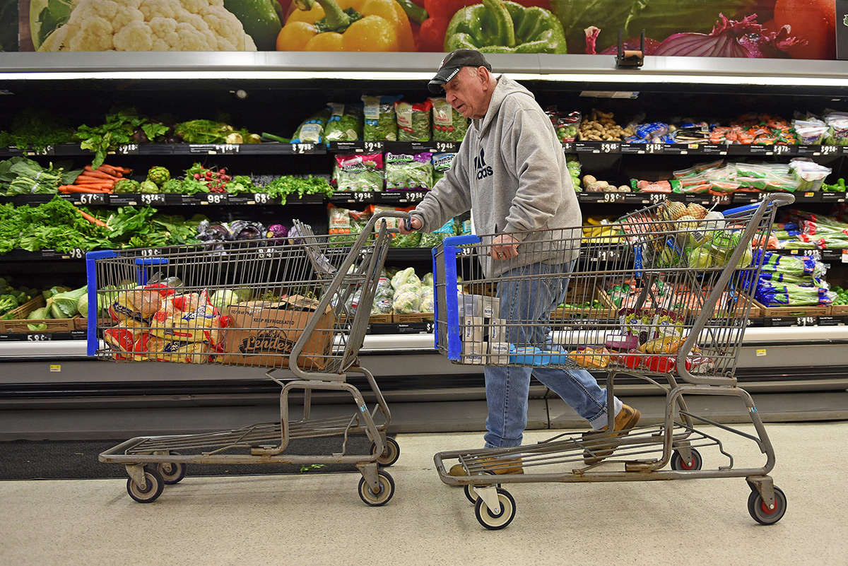 "Winston Mezo, also known as the bagel man, shops for supplies Thursday, April 27, 2017, at Wal-Mart in Carbondale before heading to the parking lot of Pinch Penny Liquors to open his ""Winston's Bagels"" cart for the last time. Mezo officially retired Sunday, though he was not able to sell his well-known snacks Friday or Saturday because of severe weather. The Herrin native has been a fixture in the community since 1983. (Anna Spoerre 