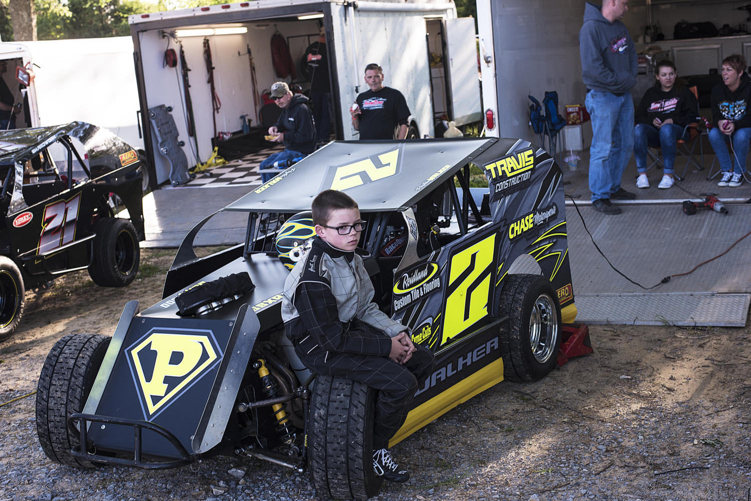 Second-generation racer Peyton Walker, 12, of Paducah, Kentucky, sits on his car awaiting the start of hot-laps Saturday, May 6, 2017, at the Southern Illinois Raceway in Marion.