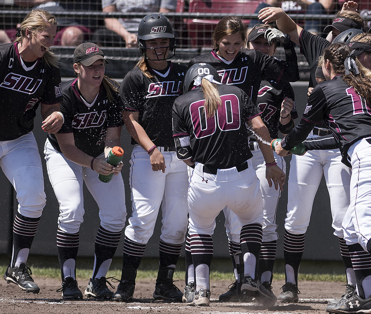 Junior catcher/infielder Sydney Jones is greeted at home plate by her teammates after hitting a 2-run homer Sunday, May 7, 2017, during the Salukis' 3-2 win against Missouri State at Charlotte West Stadium. (William Cooley | @Wcooley1980)