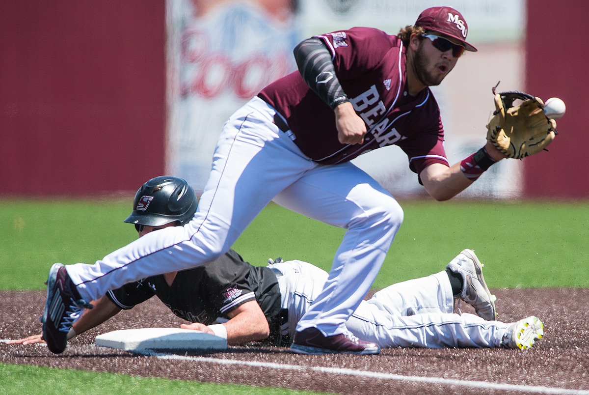 Missouri State junior infielder Jake Burger catches the ball as Saluki junior catcher Nick Hutchins slides into third during SIU's matchup against Missouri State on Sunday, May 7, 2017, at Itchy Jones Stadium. The Salukis lost to the Bears 7-4 after 11 innings. Burger scored one run during the game. (Jacob Wiegand | @jawiegandphoto)