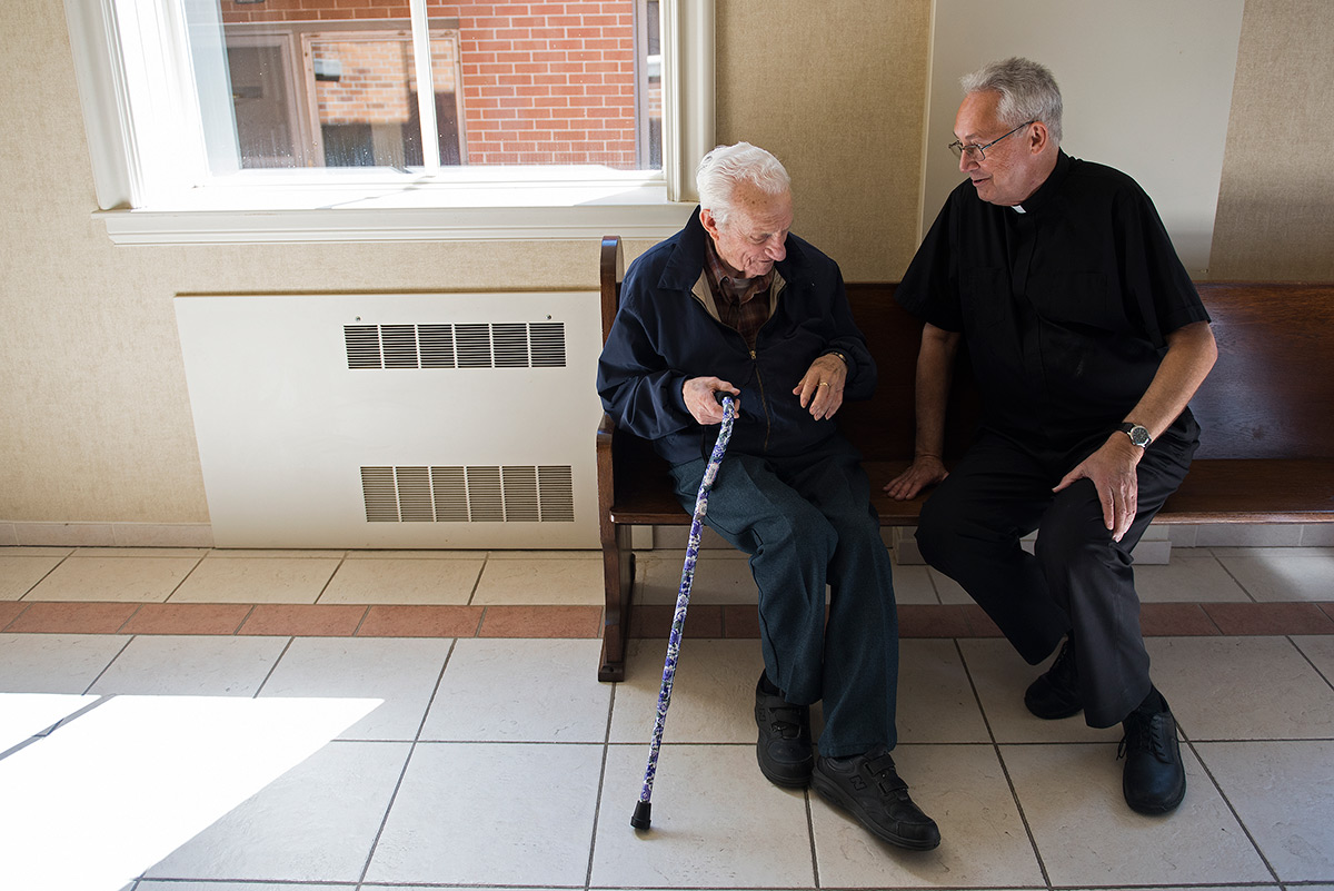 Sam+Garnati%2C+a+93-year-old+who+has+attended+OLMC+his+entire+life%2C+speaks+with+Monsignor+Ken+Schaefer+before+the+11+a.m.+Sunday+service+April+23%2C+2017%2C+at+Our+Lady+of+Mount+Carmel+in+Herrin.+Garnati+said+he+has+known+Schaefer+since+he+started+at+the+church+22+years+ago.+%22He%27s+a+great+leader%2C%22+Garnati+said.+%22He%27s+outgoing+and+gracious.+He+just+seems+like+he+doesn%27t+meet+a+stranger.%22+%28Jacob+Wiegand+%7C+%40jawiegandphoto%29