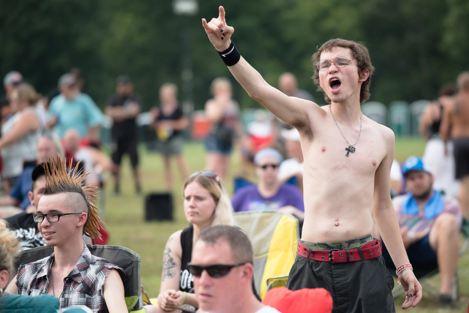 Zane Risley, of Ridgeway, pumps his fist in the air while watching Hell Yeah perform Sunday, Aug. 20, 2017, during the third day of Moonstock at Walker's Bluff Winery in Carterville.  (William Cooley | @Wcooley1980)