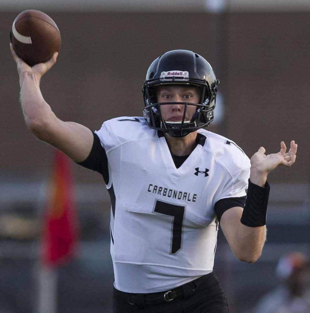 Carbondale quarterback Seth Germann fires off a pass during the 100th meeting between the Murphysboro Red Devils and the Carbondale Terriers on Friday, Aug. 25, 2017, at