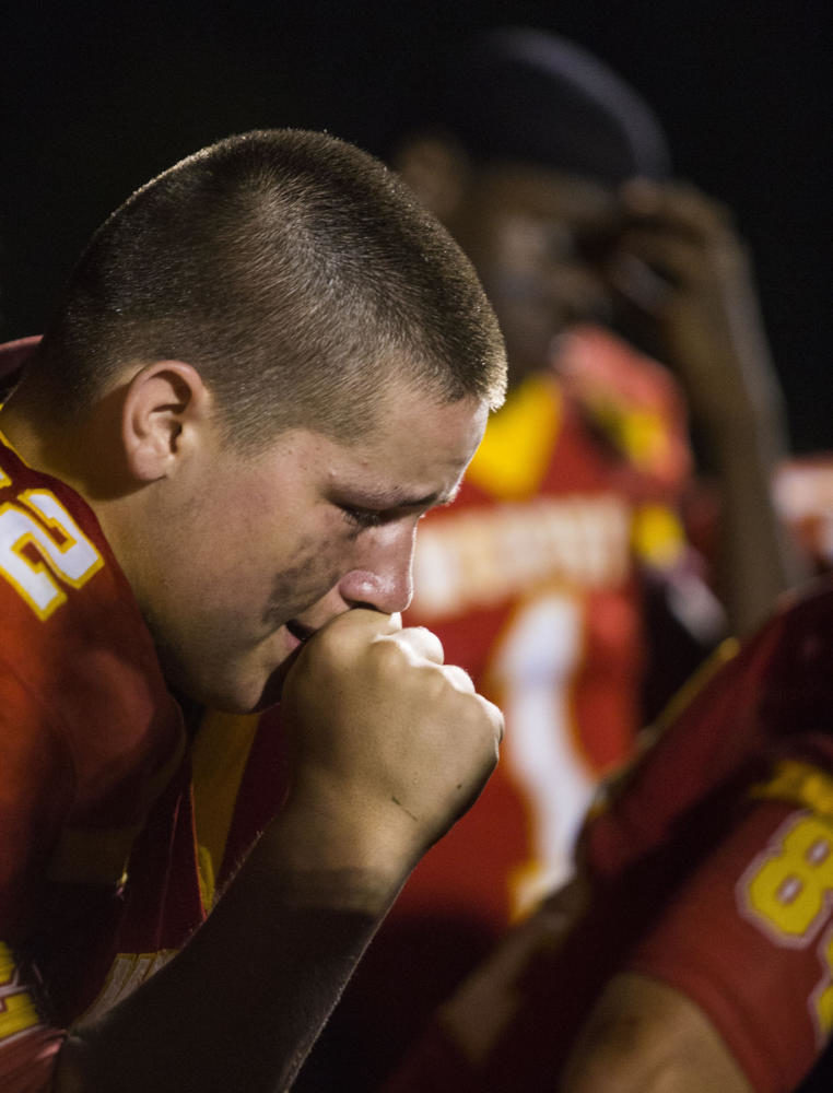 Murphysboro Red Devils A.J. Grammer chokes up after losing to the Carbondale Terriers in the the 100th meeting of the two teams on Friday, Aug. 25, 2017, at