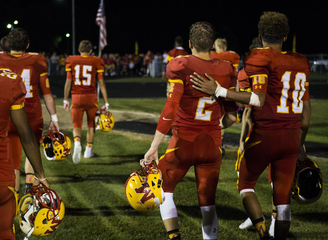 Murphysboro quarterback Gavin Topp (10) embraces running back Brandon Caldwell after losing to the Carbondale Terriers in the the 100th meeting of the two teams on Friday, Aug. 25, 2017, at