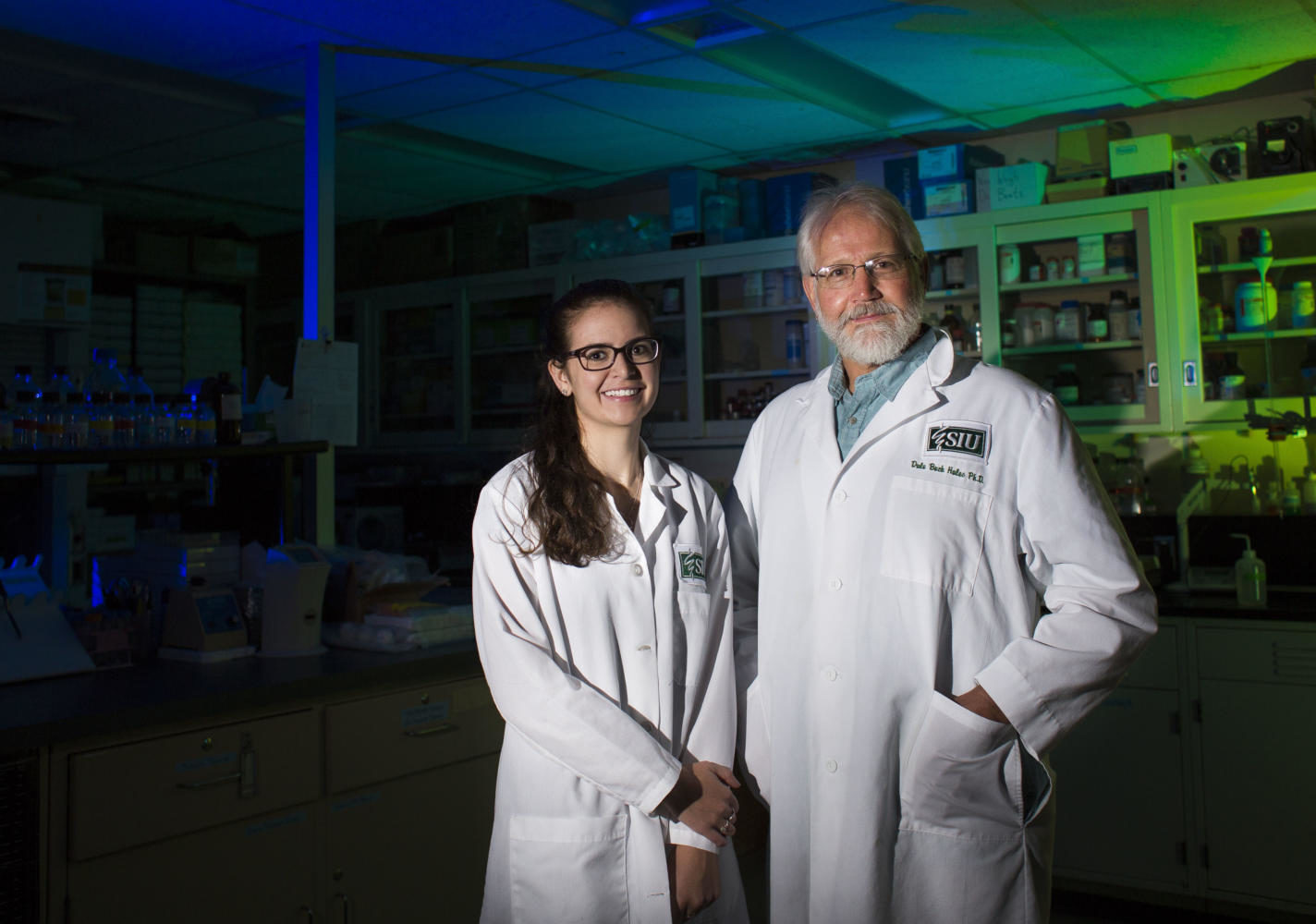 Senior physiology major Kara Starkweather, left, and Professor of Physiology Dr. Buck Hales pose for a photograph in a Life Sciences II lab Friday, Aug. 25, 2017, in Carbondale. The duo is using hens, which ovulate similarly to women, to research flaxseed as a dietary intervention in preventing ovarian cancer.