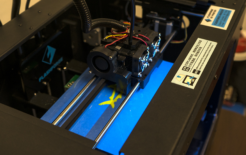 """A Flashforge Creator Pro 3-D printer is pictured Friday, Aug. 25, 2017, in Morris Library. """"There was a non-profit group that gave [the printers] to us, so we didn't have to purchase them,"""" science librarian Jennifer Horton said. Horton will be teaching a workshop on the printing units, Wednesday. (Auston Mahan 
