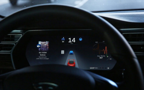 The dashboard of the software-updated Tesla Model S P90D shows the icons enabling Tesla's autopilot, featuring limited hands-free steering, making the Tesla the closest thing on the market to an autonomous-driving enable vehicle. (Chris Walker/Chicago Tribune/TNS)
